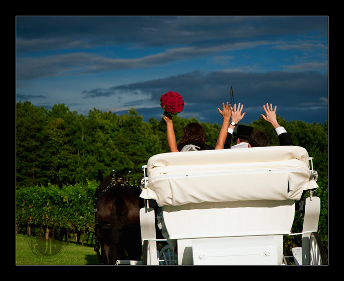 Joel and Mary raise their hands in celebration while a dark threatening sky retreats to the east. (Barbara Franks - Nikon D700)