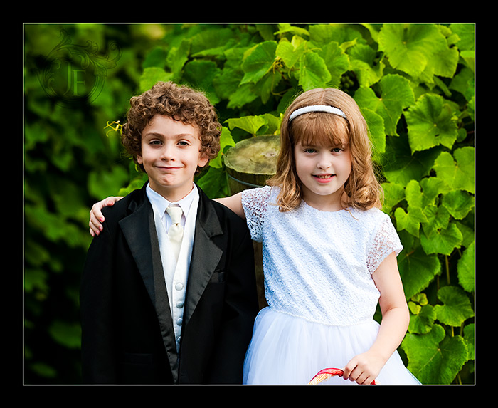 Mary's son Joshua and Joel's niece Caroline, the ring bearer and the flower girl, were just adorable and did a great job. This image was taken near the gazebo with the vines in the background. (Jeff Franks - Nikon D3)