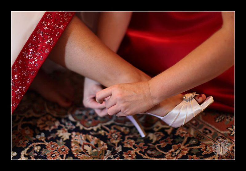 Mary getting a little help with the heels. (Kristy Dickerson - Canon 5D Mk II)
