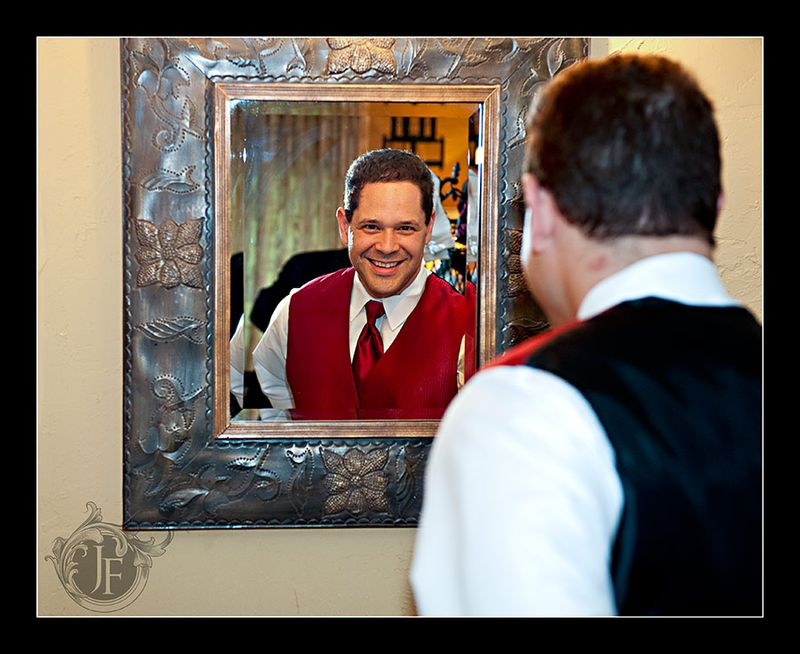 Ross, Joel's best man, getting his tie straight in the unique looking mirror. (Steve Glass - Nikon D700)