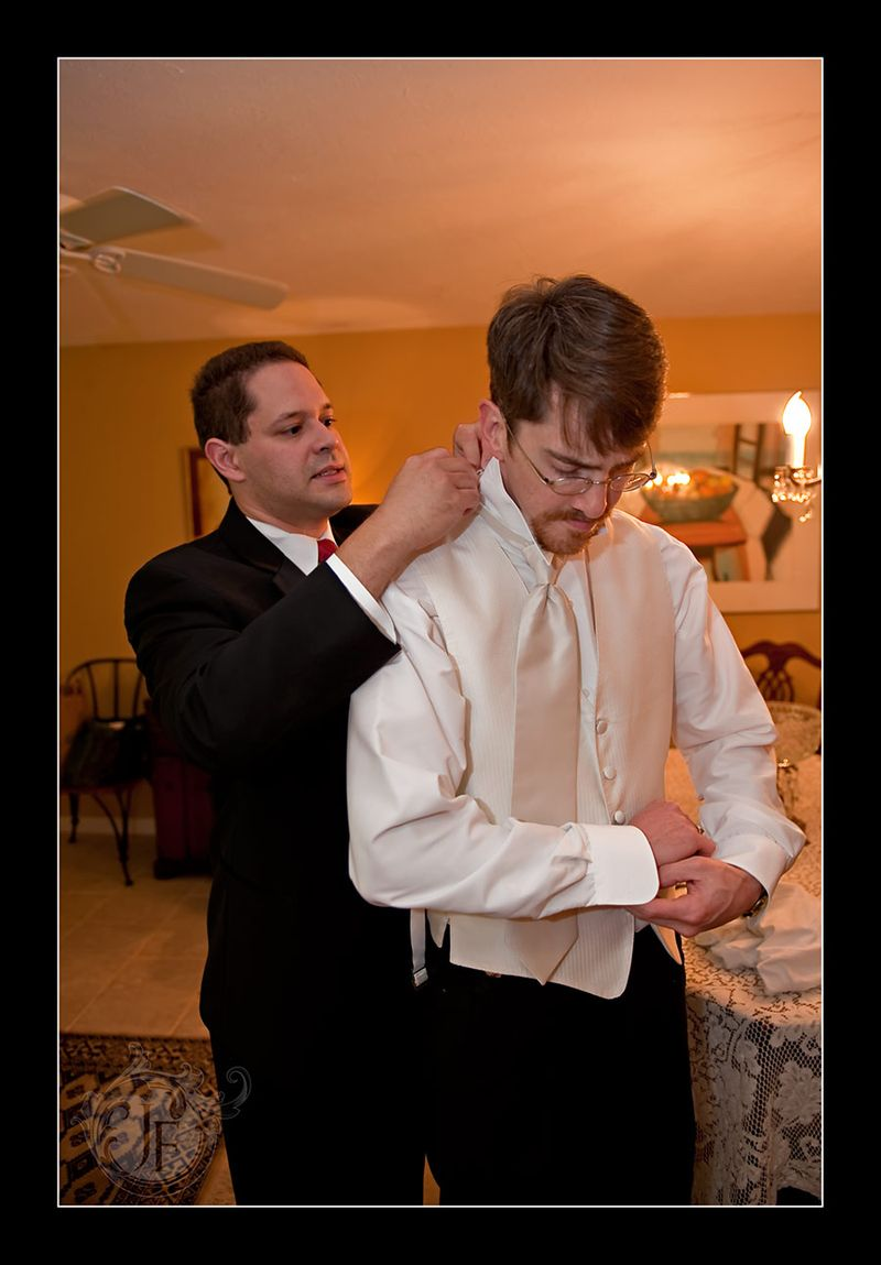 Joel, with a little help from Ross, putting on the Ritz! (Jeff Franks - Nikon D3)