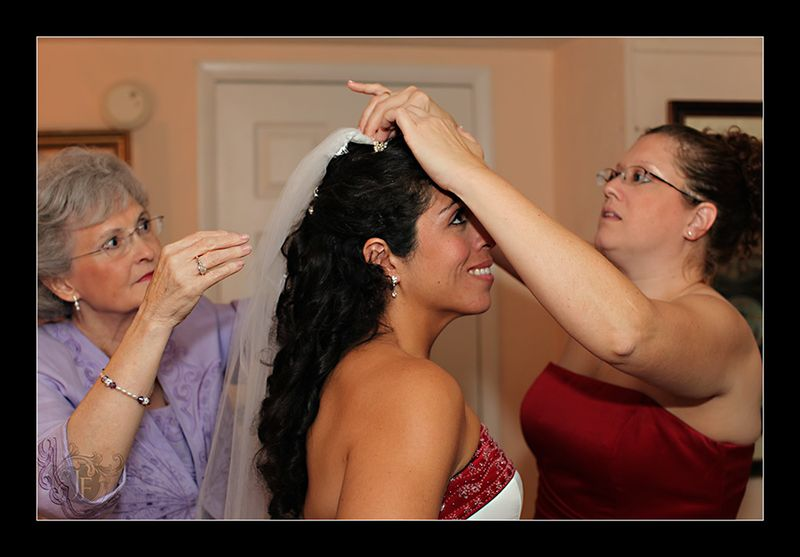 Jennifer, the Maid of Honor, and Caroline, Joel's mother, attach Mary's veil. (Kristy Dickerson - Canon 5D Mk II)