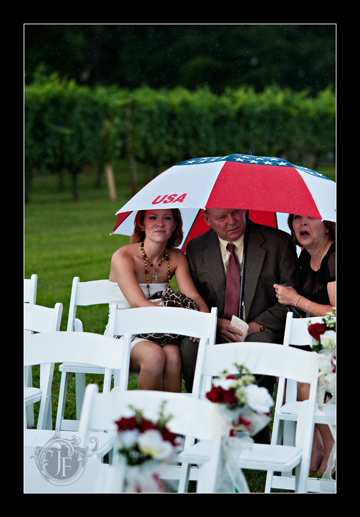 About thirty minutes before the ceremony the rain came and everyone sought shelter. (Jeff Franks - Nikon D3)