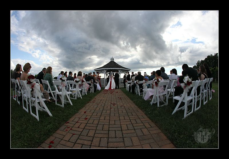 Joel and Mary at the beautiful Three Sisters Gazebo with guests in attendance. (Kristy Dickerson - Canon 5D Mk II)