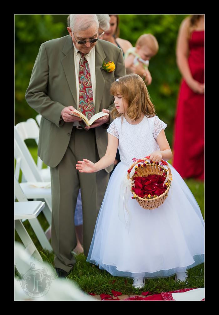 The beautiful little flower girl dropping rose petals behind Joel and Mary. (Jeff Franks - Nikon D3)