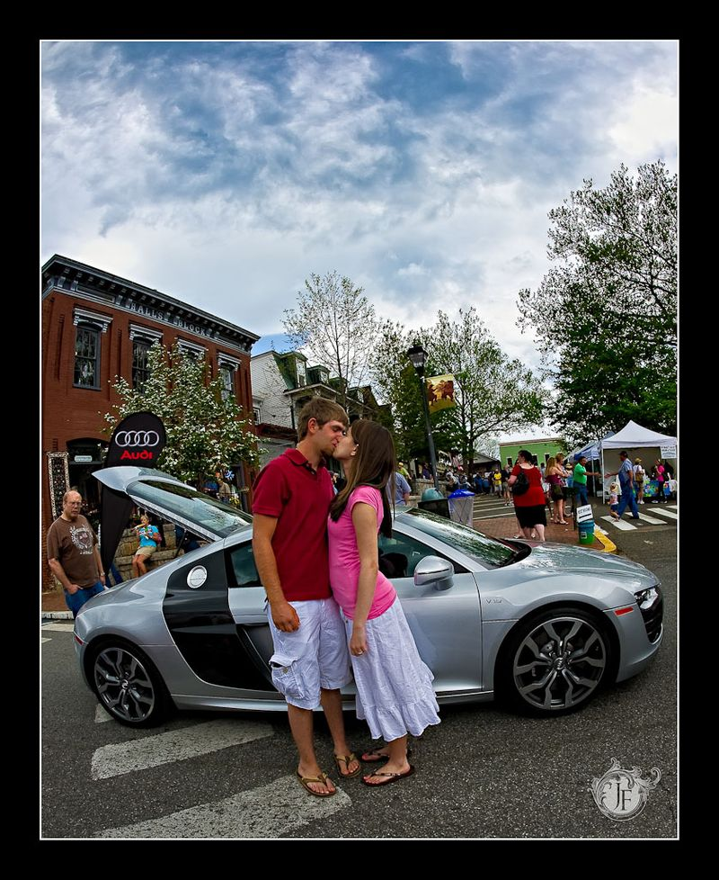 Josh & Amber in front of an Audi R8 adjacent to the square in Dahlonega.